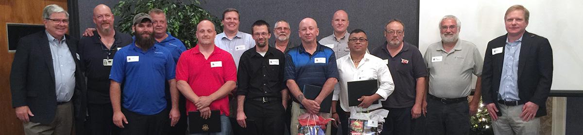 2016-2017 Technimark University Graduates line up with Don & Brad Wellington